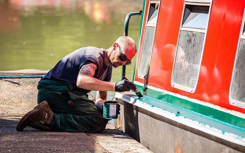 Man painting a Narrowboat